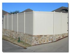 Retaining Wall with Vinyl Fence  www.modernfenceandpatio.com
