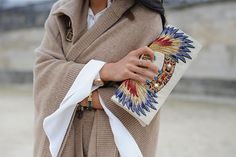 slouchy cardi with statement clutch, manicured nails