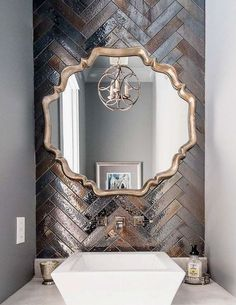 Metallic tiles and statement mirror create a stunning feature wall.