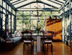 Wood floors + cabinet + daybed + table & chairs + unique chandelier = the sun house