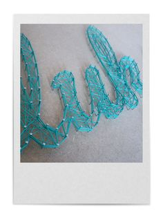 STRING-ART | FILLED LETTERS: Follow step 1 & 2 of the NORMAL PATTERN. 3. Hammer some extra nails on the empty, straight parts. 4. String a thread from nail to nail so the outer lines of the text or image become visible. 5. Carefully tear away the pattern sheet. 6. String a thread in random order from nail to nail, but keep inside the letters. Also string the outline again to make it extra visible.