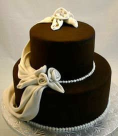 Chocolate Chanel Flower Cake By: MannyL - This was created for a small wedding where the couple wanted a simple and elegant chocolate cake. Gorgeous Cakes, Pretty Cakes, Amazing Cakes, Cupcakes, Cupcake Cakes, Cake Pops, Fantasy Cake, Small Wedding Cakes, Piece Of Cakes