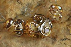 Glass Lampwork Beads Golden Swirling Aurae SRA by carolynsbeads