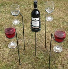 5 Piece outdoor wine sticks A set of 4 wine glass holders and a wine bottle holder to help you enjoy outdoor living on the lawn or your picnic.