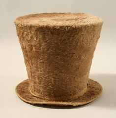 1830 -- crazy dandy top hat, with a high crown that flares noticeably.  And it's furry!