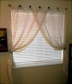 """For really wide windows.  """"Life Unexpected: How To Hang a Curtain Without A Rod."""" Painted knobs and screws. Or nails. Or a few hooks or knobs on left and right and tie backs."""
