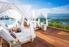 The lounge beds surrounding the Grand Luxxe Residence Sky Garden pool in Vidanta Nuevo Vallarta