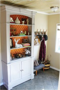 cool way to refurbish an old china hutch  Maybe stencil the inside? Paint the wooden shelves too...