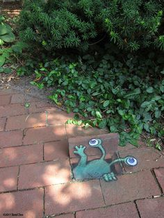 you can do little whimsical surprises around every corner of your garden tOO.........just like the WONDROUS chalk drawn adventures of sluggo in his street art....by the AMAZING david zinn!!! pleeeeeeeease click through for more WILDLY creative and adorable photos!!!