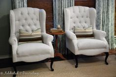 This is from 4bp.blogstop.com. I could reupholster the pink scratched-up wingchairs in a neutral tone and put them next to each other like this in the living room. i like the pillows.