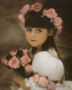 """That looks vintage. Such a pretty and romantic picture of this little """"flower girl"""". Am I the only one who thinks she kinda looks like Matilda?"""
