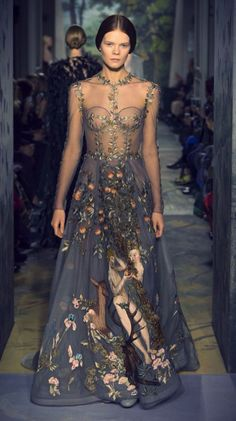 """Valentino spring 2014 couture collection- """"Le jardin d'Eden"""", a zirconium-colored tulle dress, embroidered in silk threads, with a scene of Adam and Eve in the Garden of Eden inspired by the painting """"Adam and Eve"""" by Lucas Cranach in 1526, taking 2,200 hours to hand embroider.Credit:girlannachronism VALENTINO"""