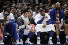 From left, New York Knicks forward Amare Stoudemire, guard Jeremy Lin, foward Carmelo Anthony and center Tyson Chandler sit on the bench in the fourth quarter of the Knicks' 99-82 victory over the Atlanta Hawks in an NBA basketball game at Madison Square Garden in New York, Wednesday, Feb. 22, 2012.