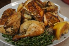 The BEST ROAST CHICKEN with rosemary, thyme, fresh oranges, lemons and garlic.