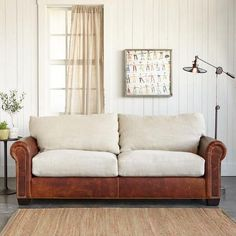 Sectional Sofa Landon Leather Sofa White linen slip cased cushions lend cool contrast to a traditional roll arm leather sofa finished with nailhead trim and built upon a