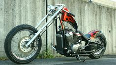 Honda Shadow vt600 hardtail custom with downtube/backbone stretch and flame paint job by Goods Co. Customs | left front