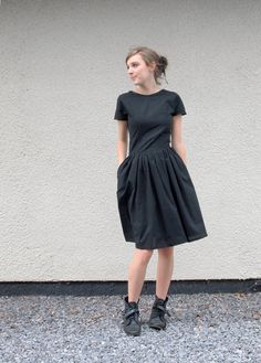 {little black tshirt dress} so Audrey! ♥ the pockets! + cool styling with the boots.