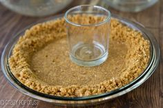pressing the BEST Graham Cracker Crust into a pie pan