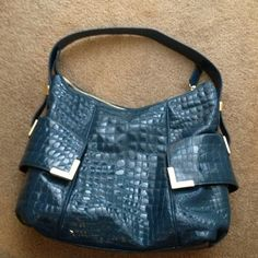 Reduced!! Patent leather Michael Kors hobo bag! Authentic hobo bag in Croc embossed blue patent leather. Both sides have flap pockets with magnetic snap. Inside has lots of storage options and MK logo interior. Use a few times but in perfect condition. Bundle discounts!! Michael Kors Bags Hobos