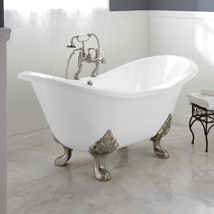 Maybe this is like the one Dad put downstairs? IDK? NolaWest********* Celine Cast Iron Clawfoot Tub - Bathroom
