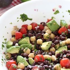 Fiesta Bean Salad. black beans, chick peas, avocado, tomato, onion, cilantro, lime
