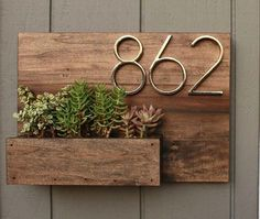This house number planter box makes the perfect addition to any front porch. We start by staining poplar wood a Dark Walnut color and seal it well with a water based, satin finish polyurethane. Three holes are drilled into the bottom of the planter box se Wooden Table Diy, Table En Bois Diy, Diy Table, Wood Table, Diy Wood, Wood Crafts, Paper Crafts, Succulents, Succulent Plants