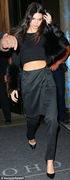 Make way: Kendall Jenner turned heads in a bold all-black getup, consisting of satin-like trousers and a fluffy blouse with matching heels