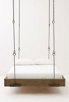 "hanging bed---Tiffani, remember how I said ""why doesn't someone invent a bed that rocks--this is close to it"