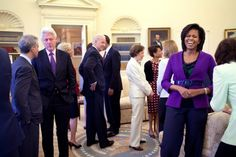 First Lady Michelle Obama and President Barack Obama, background, greet guests in the Oval Office, April 21, 2009, including former President Bill Clinton, U.S. Senator Edward M. Kennedy, former first lady Rosalynn Carter, center, along with Vice President Joe Biden. (Official White House Photo by Pete Souza)