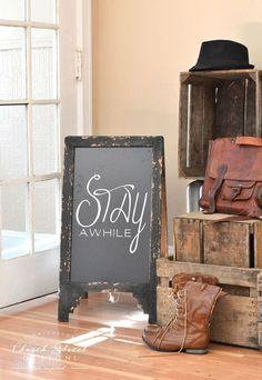 "Beautiful, Double Sided A Frame Chalkboard. Perfect for weddings, parties and events. Chalkboard Easel is great for restaurant and coffee shop menus.This Sandwich Chalkboard sign comes with a permanent ""Stay Awhile"" on one side and is blank on the other side for you to write your own messages."