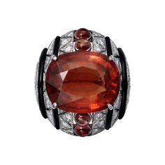 L'Odyssée de Cartier Parcours d'un Style 'Africa' high jewelry ring in Platinum, one 24.14-carat cushion-shaped brown tourmaline, cabochon-cut orange sapphires, onyx, brilliants.