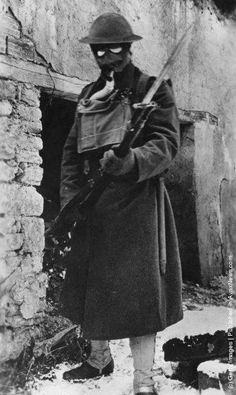 An American soldier dressed for a gas attack during World War I circa 1916.