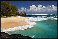 Beach and  turquoise waters, and homes  near Haena. North shore, Kauai island, Hawaii, USA (color)
