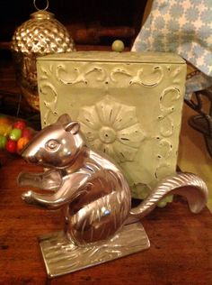 A personal favorite from my Etsy shop https://www.etsy.com/listing/520239151/squirrel-nut-cracker-retro-nut-cracker