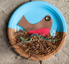 "craft thursday = robin style this craft was found via the crafty crow....like so many of my great ideas....she finds them first for me. we started with paper plates and paint. we had those really heavy duty chinet plates....they worked awesome for this craft! we painted half of the plate ""sky"" blue and the other half ""nest"" brown. then we used A LOT of school glue and began fluffing our nests. we used brown packing shredded stuff that i have had for a long time. and s..."