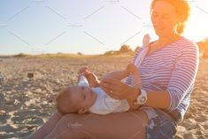 Woman with little baby on sea by Sova on A cheerful dark-haired woman holding a baby girl in her hand and playing with her on the beach. Concept of summer holidays at sea and live style ❤ Affiliate ad link. Holding Baby, Photos For Sale, Little Babies, Cheer, Concept, Sea, Holidays, Woman, Dark