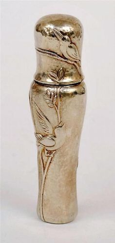 A perfume bottle by Tiffany & Co, styled in sterling silver,