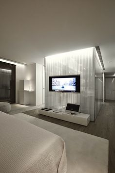 Stunning S House Bedroom Design With Private TV Unit Studded On The Center Wall Above Base Low Cabinet For Storage