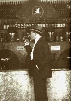 Fernando Pessoa drinking a glass of wine in a tavern in 1929.