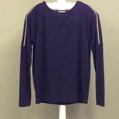 MICHAEL Michael Kors navy top Size large. Two gold zippers on both sleeves measure 14 inches. Zippers actually work. Sleeves measure 30 inches. From neckline to bottom of top measure 23.5 inches. There is a tiny iron mark, about 1 inch, in the center of the shirt and also on the back. Refer to 3rd picture! I've tried and the tiny mark on the back will not show up in pictures. Other than that, the shirt is in great condition. 94% polyester and 6% spandex. Feel free to ask me any questions…