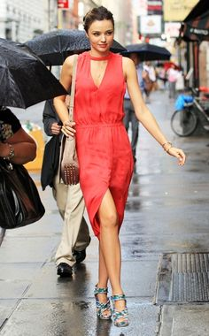 I love that other people are under umbrellas but Miranda Kerr is just strolling about.  ALC dress, Balenciaga shoes, and A Wang bag.  NYC