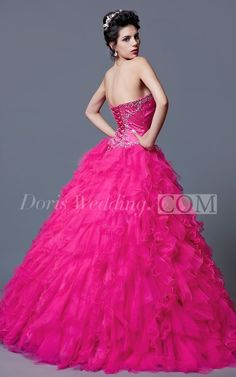 A full floor length quinceanera ball gown with cascading ruffles throughout the whole skirt. A sweetheart neckline continues around to create a low backline, with a silky criss cross lace fastening to the back. The snug fitting bodice to the front and back, is detailed with sparkling sequined designs. Comes with full lining and a fitted boned bra for added comfort and style.
