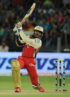 Royal Challengers Bangalore Chris Gayle plays a shot during the IPL Twenty20 cricket match between Pune Warriors India and Royal Challengers Bangalore at The Subroto Roy Sahara Stadium in Pune on May 11, 2012.