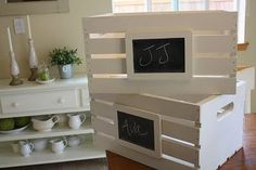 Great storage idea--attach small chalkboards to the front of wooden crates and paint :)