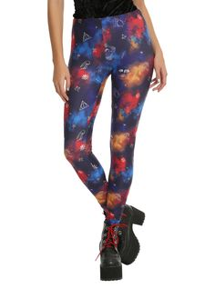 Wear the magic of your favorite book series with these leggings from  Harry Potter . Featuring a colorful background that looks the night sky and a potion collided, these leggings have an allover symbol print that includes Harry's glasses, lightning bolts, the Deathly Hallows and more!   95% cotton; 5% spandex  Wash cold; dry low  Imported  Listed in junior sizes