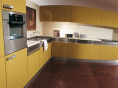 Kitchen:Three Yellow Kitchens You Must See And Apply In Your Home Interesting Design For Inspiring Idea With Yellow Colour Choosing For Modern Kitchen With Stainless Steel Countertops