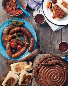 There's nothing like the smell of sausages and chiles sizzling on a grill to get appetites going. || Grilled Sausages with Charred Tomato Relish Recipe