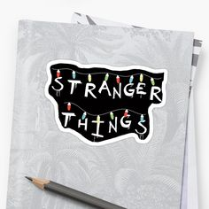 """""""Stranger Things"""". You recognize this from Will's Mother's Wall! For who loves Eleven (Millie Bobby Brown), Mike (Finn Wolfhard), Dustin (Gaten Matarazzo), Lucas (Caleb McLaughin), Will (Noah Schnapp), Joyce (Winona Ryder), Chief Hopper (David Harbour). #strangerthings, #netflix #strangerthingsfan #nerd #geek #friendsdontlie #eleven #mike #dustin #lucas #chiefhopper #hawkins #upsidedown #dungeonsanddragons #sticker #notebook #journal #stationery #student #redbubble Stranger Things Lights, Don T Lie, Xmas Lights, Winona Ryder, Nerd Geek, Bobby Brown, Dungeons And Dragons, Geek Stuff, Iphone Cases"""