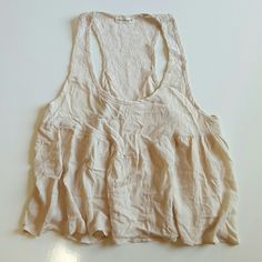 Light  flowy light top Adorable low scoop neck tank top in a very light baby pink or cream like color. This is a very soft and flowy light shirt that has beautiful lace floral design. Worn once, its just to big for me. Great for a classy easy night outfit, great with jeans or slacks. Peach Royal Tops Tank Tops