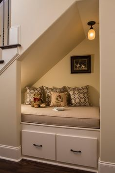 Traditional Staircase with Hardwood floors, flush light, Built-in bookshelf